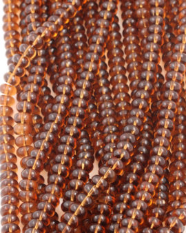 Disc Shape Glass Beads 7x11mm. Sold per strand approx 58 beads amber transparent