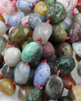 Agate nuggets, size vary. Sold per strand approx. 18 beads
