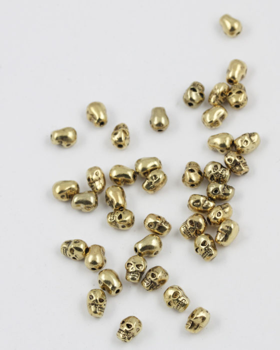 skull bead antique gold